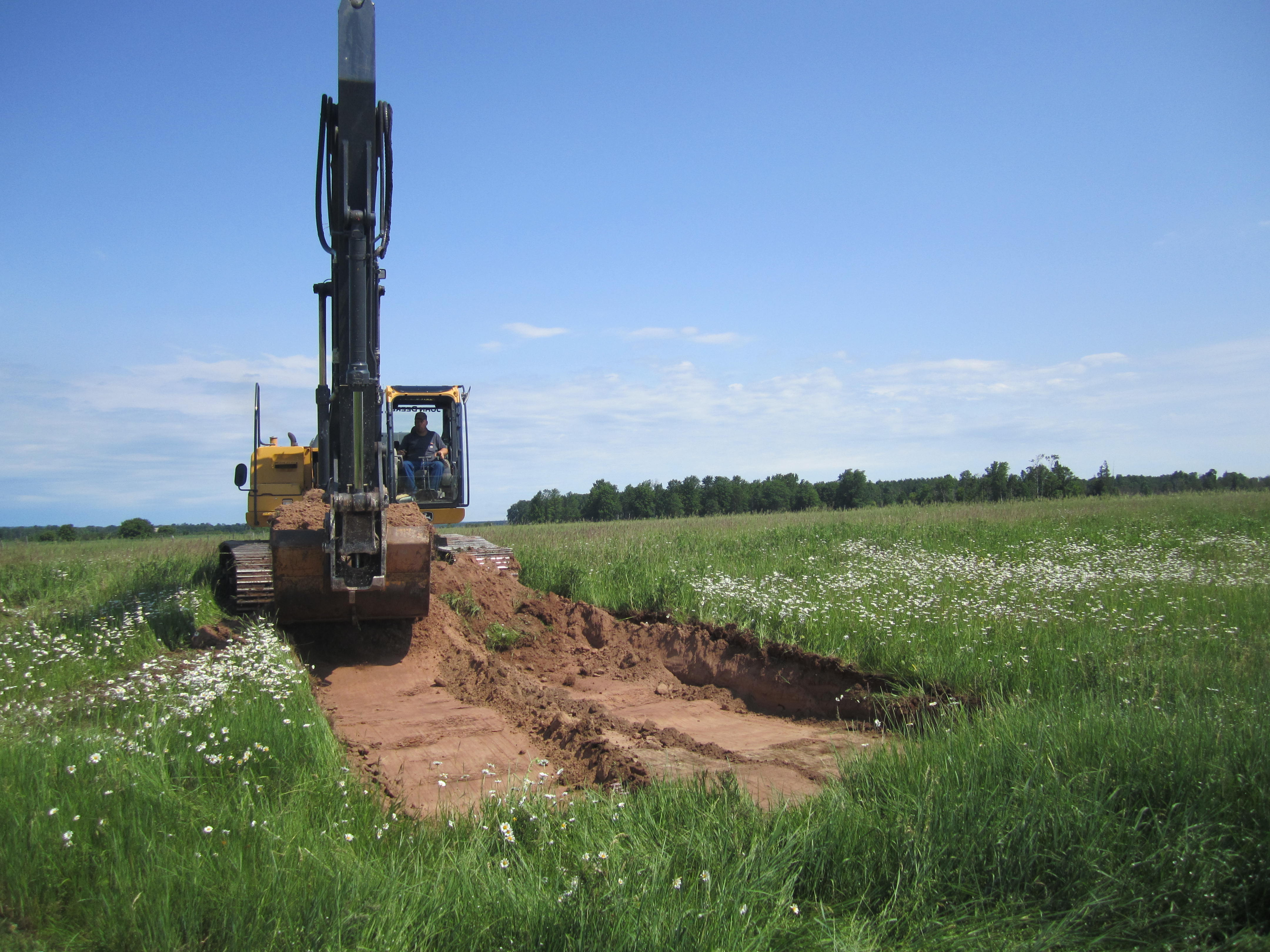 Opening a new pit at the Arnheim farm of Upper Peninsula, MI, in the search of more wood.